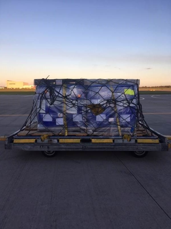 Air freight shipment on tarmac